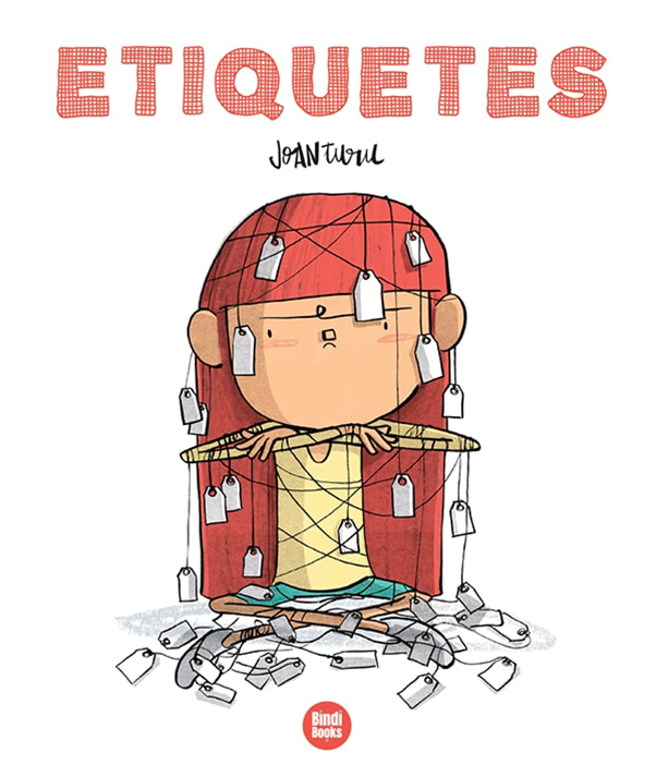 """Etiquetes"", Joan Turu. Bindi Boks. A child with an angry expression with many paper labels attached to his body with string."
